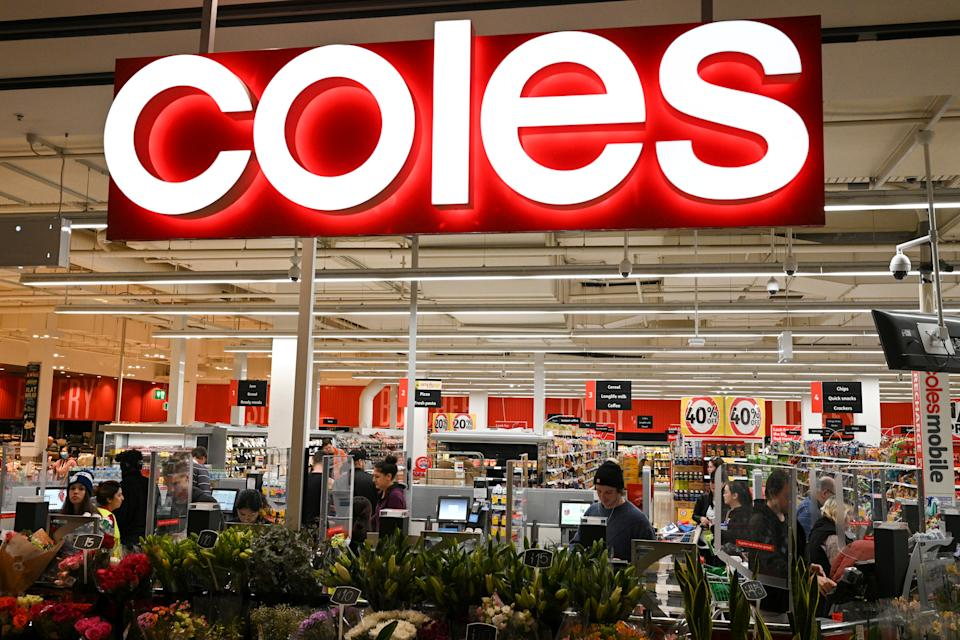 Customers separated by protective plexiglass shields are seen in the self-service checkout area of a Coles supermarket following the easing of restrictions implemented to curb the spread of the coronavirus disease (COVID-19) in Sydney, Australia, June 17, 2020.  REUTERS/Loren Elliott