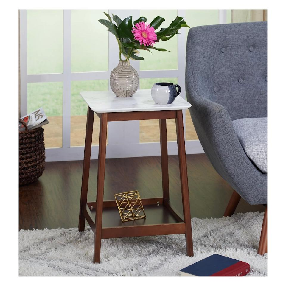 """<p>The marble top and wooden legs on the <a href=""""https://www.popsugar.com/buy/Jhovies-End-Table-474312?p_name=Jhovies%20End%20Table&retailer=target.com&pid=474312&price=55&evar1=casa%3Auk&evar9=46443084&evar98=https%3A%2F%2Fwww.popsugar.com%2Fhome%2Fphoto-gallery%2F46443084%2Fimage%2F46443085%2FJhovies-End-Table&list1=target%2Cfurniture&prop13=api&pdata=1"""" rel=""""nofollow"""" data-shoppable-link=""""1"""" target=""""_blank"""" class=""""ga-track"""" data-ga-category=""""Related"""" data-ga-label=""""https://www.target.com/p/jhovies-end-table-walnut-buylateral/-/A-53174128"""" data-ga-action=""""In-Line Links"""">Jhovies End Table</a> ($55) make it a great decorative furniture piece. Not to mention, its shelf is useful for extra storage.</p>"""