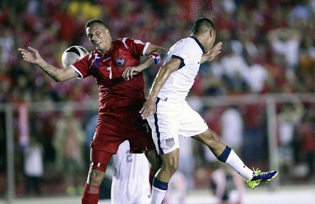 U.S. Edgar Castillo, right, and Panama's Blas Perez go for a header during a 2014 World Cup qualifying soccer match in Panama City, Tuesday, Oct. 15, 2013. (AP Photo/Arnulfo Franco)