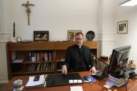 Hans Zollner, head of the new safeguarding institute at the Pontifical Gregorian University, sits in his office before an interview with the Associated Press, in Rome, Wednesday, Oct. 13, 2021. The Catholic Church's foremost research and training institute into clergy sexual abuse of minors is expanding its mandate to also include the sexual and spiritual abuse of adults, evidence that the Vatican is increasingly aware that children aren't the only victims of clergy who abuse their power and authority. (AP Photo/Alessandra Tarantino)