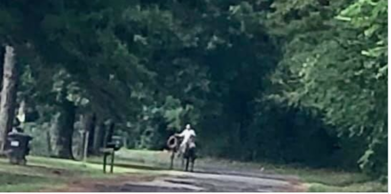 A black man was threatened by a man on horseback carrying a rope in a Texas neighborhood. (Credit: James Ragland/Facebook)