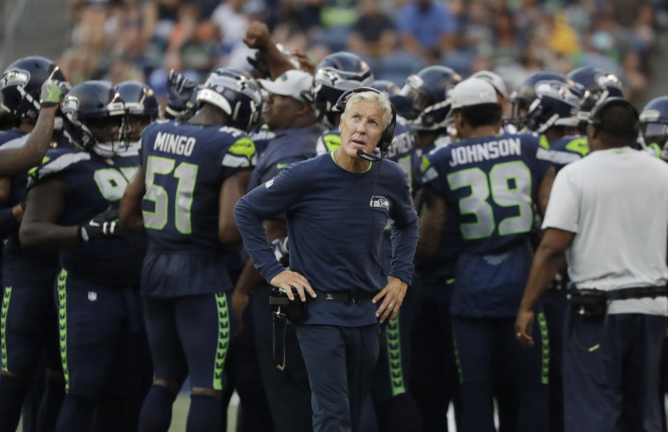 Seattle Seahawks head coach Pete Carroll looks toward the scoreboard during the first half of an NFL football preseason game against the Indianapolis Colts, Thursday, Aug. 9, 2018, in Seattle. (AP Photo/Elaine Thompson)