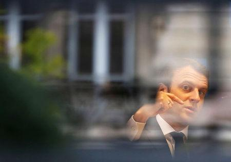 Emmanuel Macron, head of the political movement En Marche !, or Onwards !, and candidate for the 2017 presidential election, is pictured through a window of his hotel during a campaign visit in Rodez, France