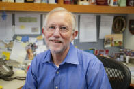 Charles M. Rice, professor of virology at Rockefeller University, poses for a portrait in his laboratory office, Monday, Oct. 5, 2020, in New York. Rice was awarded the Nobel Prize for Medicine or Physiology on Monday for the discovery of the hepatitis C virus along with fellow American Harvey J. Alter and British-born scientist Michael Houghton. (AP Photo/John Minchillo)