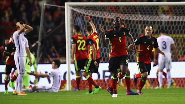 <p>Everton's Romelu Lukaku celebrates scoring an 89th-minute equaliser against ten man Greece, before the visitors saw another red card in injury time. </p>