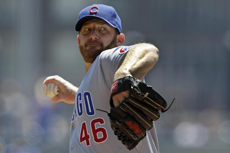 File-This July 25, 2012 file photo shows Chicago Cubs pitcher Ryan Dempster pitching during the second inning of a baseball game against the Pittsburgh Pirates in Pittsburgh.  The Texas Rangers have obtained Ryan Dempster from the Chicago Cubs, a move to fortify their rotation for the stretch run. The AL West leaders sent minor leaguer infielder Christian Villanueva and pitcher Kyle Hendricks to Chicago as part of  a deal Tuesday July, 31, 2012. Dempster, who had power to block deals, had refused to approve a trade to Atlanta last week. The 35-year-old right-hander was 5-5 with a 2.25 ERA in 16 games for the Cubs and can become a free agent after the season. (AP Photo/Gene J. Puskar, File)