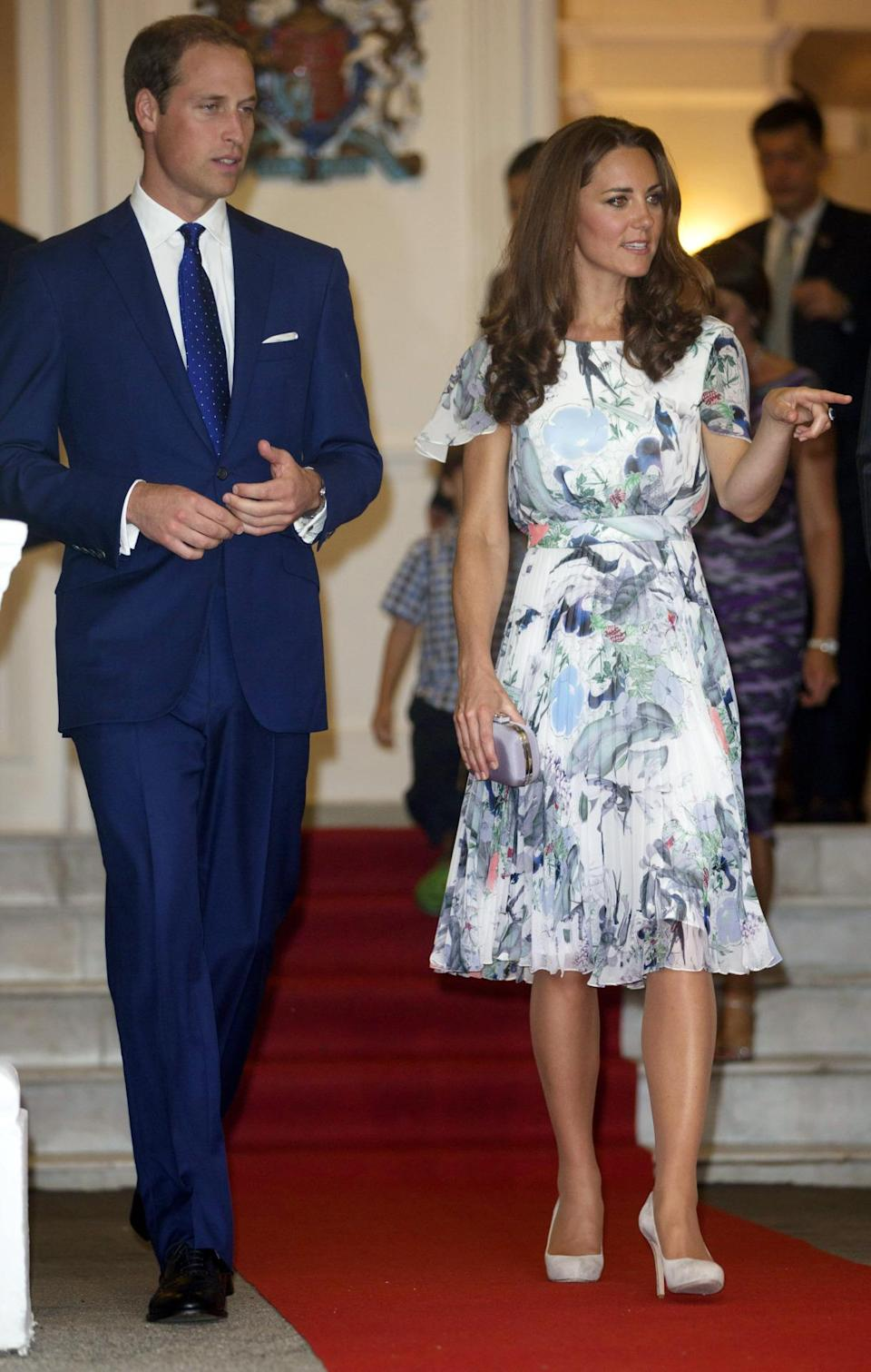 <p>For a reception in Singapore, Kate opted for a lightweight Erdem dress featuring floral detailing. She accessorised with suede L.K. Bennett heels and a grey clutch. </p><p><i>[Photo: PA]</i></p>