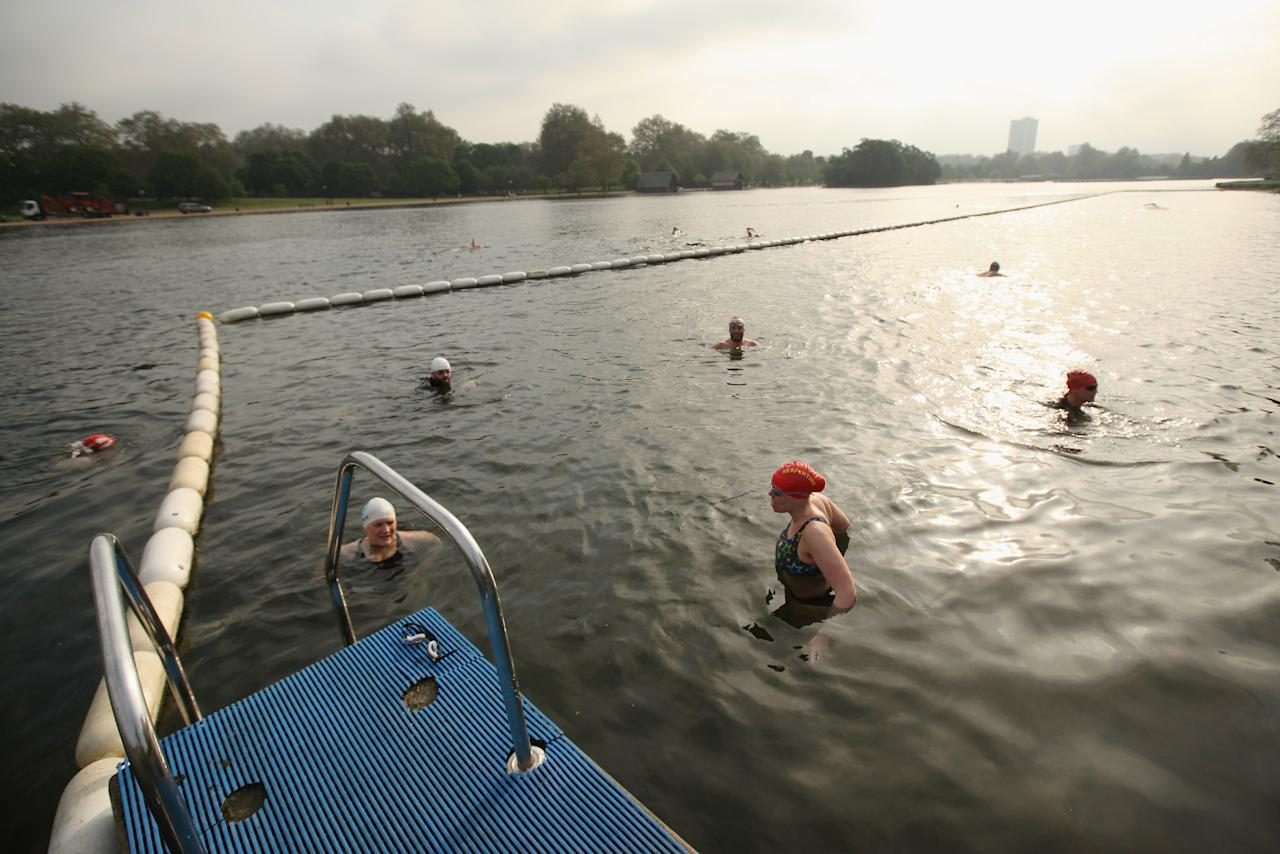 Swimmers Take An Early Dip In The Serpentine Lido