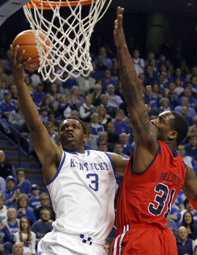 Kentucky's Terrence Jones, left, goes to the basket as Mississippi's Murphy Holloway defends during the first half of an NCAA college basketball game in Lexington, Ky., Saturday, Feb. 18, 2012. (AP Photo/James Crisp)