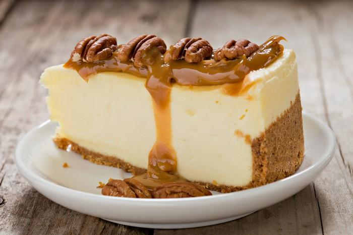 Cake with pecans on top.