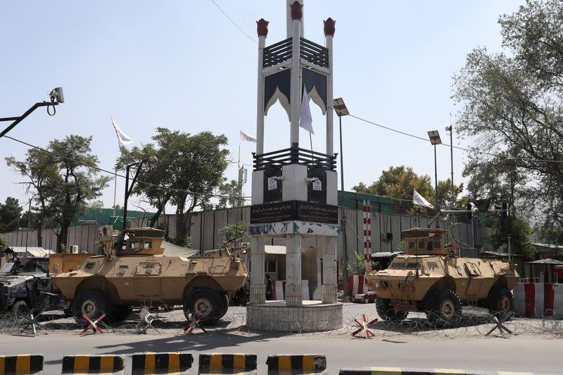 Armored vehicles are seen in front of the presidential palace in Kabul