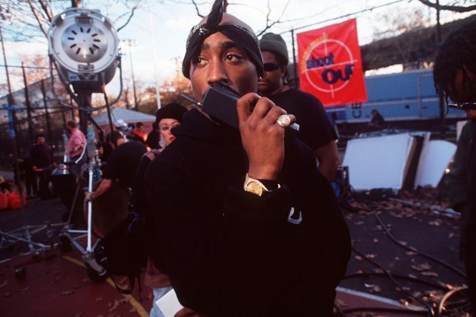 Tupac talks into a walkie talkie backstage. Source: Getty Images