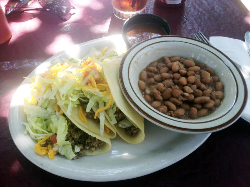 In this Sept 5, 2013 photo, a soft taco plate from El Patio de Albuquerque is shown. El Patio is a longtime, unpretentious eatery near Albuquerque's University of New Mexico campus, and is one of the city's most popular dining spots. For nearly four decades, multi-generational families, tourists, professors, students _ even celebrities _ have lined up outside this former house for robust but simple fare. (AP Photo/Russell Contreras)