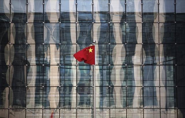 File photo of Chinese national flag at the headquarters of a commercial bank on a financial street near the headquarters of the People's Bank of China, China's central bank, in central Beijing