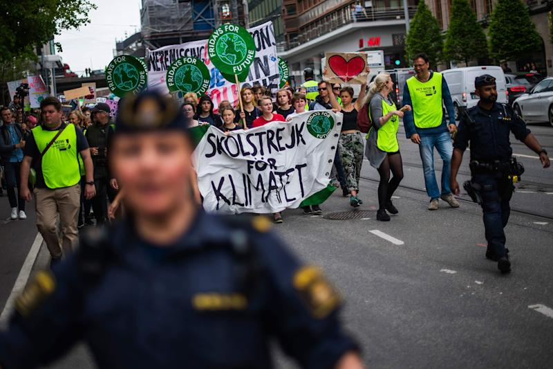 Greta Thunberg (2ndL behind the banner), the 16-year-old Swedish climate activist, marches during the