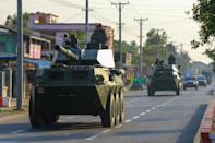 Soldiers ride in military armoured vehicles in Myitkyina, Kachin state on February 3, 2021, two days after the military in Myanmar launched a coup