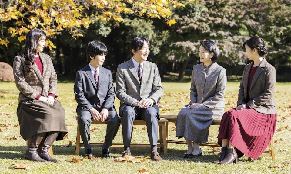 Crown Prince Fumihito, centre, talks with his wife Crown Princess Kiko, second right, and their children, Princess Mako, left, Prince Hisahito, second left, and Princess Kako, far right.