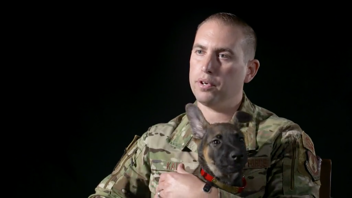 Brian, a puppy with the Master Sgt. Steve Kaun, Air Force Military Working Dog Program Manager. (Source: 502nd Air Base Wing Public Affairs)