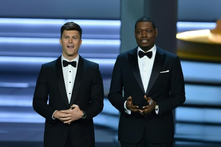 "The hosts of the 2018 Emmys, ""Saturday Night Live"" stars Colin Jost (L) and Michael Che (R), were adequate but the show earned all-time low ratings; the show will go hostless this year (AFP Photo/Robyn BECK                         )"