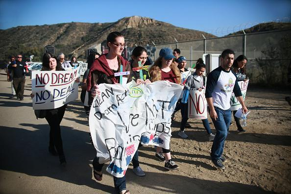 Activists and immigrants march to the border during a rally along the U.S.-Mexico border in support of passage of the Dream Act Feb. 7, 2018 in San Ysidro, California. The rally coincides with the eve of Congress's spending bill deadline with organizers urging lawmakers to pass a clean Dream Act without provisions for a border wall. (Photo by Sandy Huffaker/Getty Images)