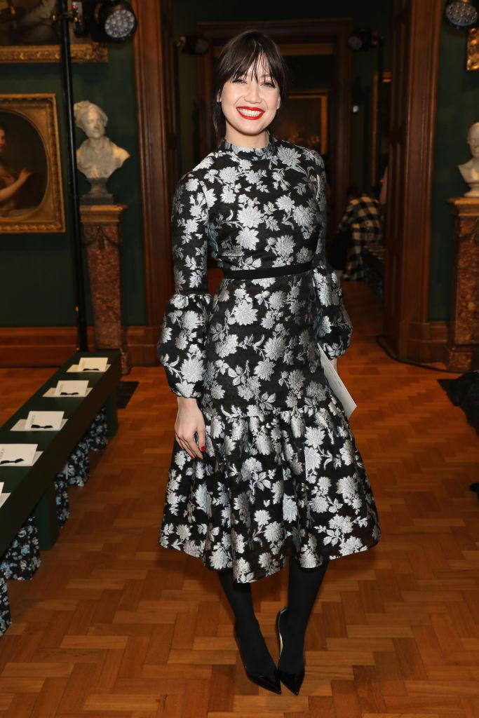 <p>Daisy Lowe donned a midi dress emblazoned with flowers for the Erdem show this season. <em>[Photo: Getty]</em> </p>