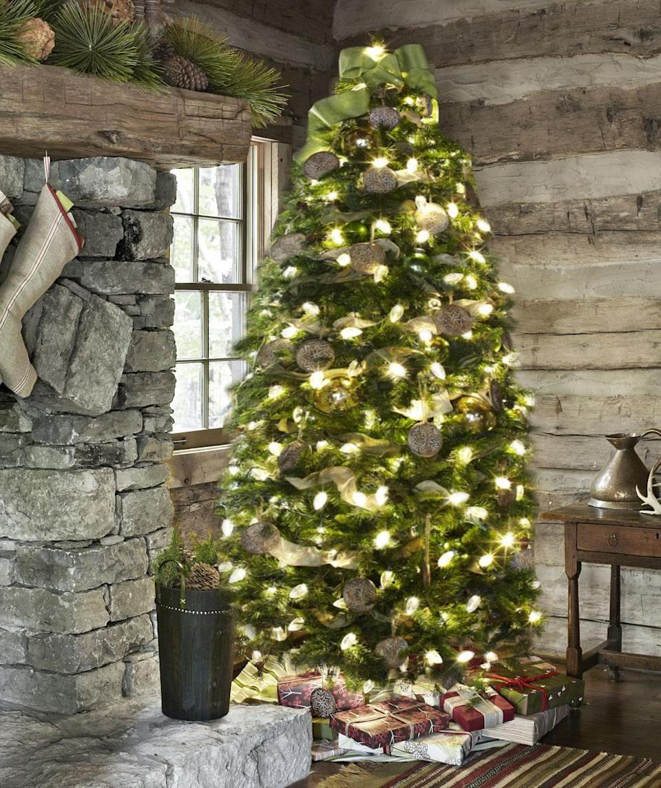 """<p>There's no need to go out and buy an expensive tree topper. Top your Christmas tree with an elegant ribbon tree topper that's easy to make yourself. Simply tie a big bow in your favorite wire-edged ribbon, then, by threading <a href=""""https://www.amazon.com/Livder-Flexible-Christmas-Wreaths-Arrangements/dp/B07R5HJ7WZ?tag=syn-yahoo-20&ascsubtag=%5Bartid%7C10050.g.28703522%5Bsrc%7Cyahoo-us"""" rel=""""nofollow noopener"""" target=""""_blank"""" data-ylk=""""slk:green florist's wire"""" class=""""link rapid-noclick-resp"""">green florist's wire </a>through the back side of the bow's knot, secure the bow to the top branch. Leave the ends extra long for a more dramatic tree topper. </p><p><a class=""""link rapid-noclick-resp"""" href=""""https://www.amazon.com/Fuzzy-Fabric-Thick-Wired-Ribbon/dp/B07V9XXJV7/ref=sr_1_5?tag=syn-yahoo-20&ascsubtag=%5Bartid%7C10050.g.28703522%5Bsrc%7Cyahoo-us"""" rel=""""nofollow noopener"""" target=""""_blank"""" data-ylk=""""slk:SHOP RIBBON"""">SHOP RIBBON</a></p>"""