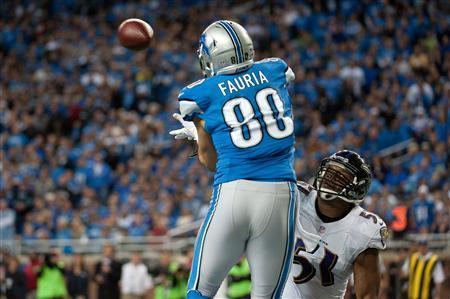 Dec 16, 2013; Detroit, MI, USA; Detroit Lions tight end Joseph Fauria (80) makes a touchdown catch will being pressured by Baltimore Ravens inside linebacker Daryl Smith (51) during the fourth quarter at Ford Field. Mandatory Credit: Tim Fuller-USA TODAY Sports