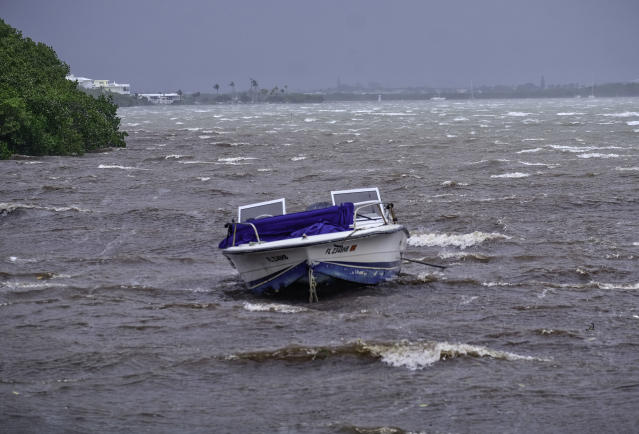 <p>A powerboat sits moored in shallow rough seas in the Florida Keys as winds and rain from the outer bands of Hurricane Irma arrive in Islamorada, Fla., on Sept. 9, 2017. (Photo: Gaston De Cardenas/AFP/Getty Images) </p>