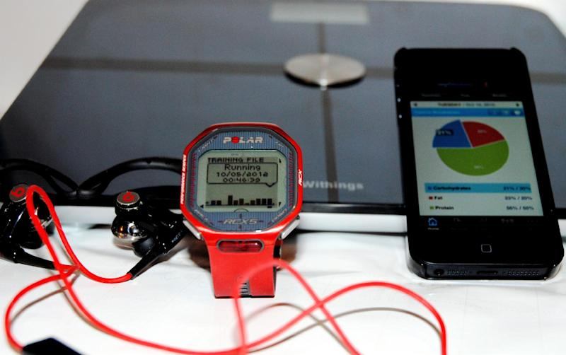 A variety of health technology accessories are displayed in Richmond, Va., on Tuesday, Oct. 16, 2012. While losing weight and staying fit can be tough, technology can help play an important role in keeping a person accountable, tracking his or her progress and making workouts more effective. (AP Photo/Michael Felberbaum)