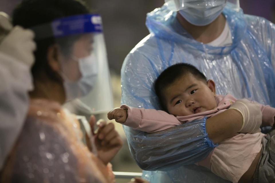 A Chinese baby from Shanghai, who arrived at Suvarnabhumi airport with others on special tourist visas, in Bangkok, Thailand, Tuesday, Oct. 20, 2020. Thailand on Tuesday took a modest step toward reviving its coronavirus-battered tourist industry by welcoming 39 visitors who flew in from Shanghai, the first such arrival since normal traveler arrivals were banned almost seven months ago. (AP Photo/Wason Wanichakorn)
