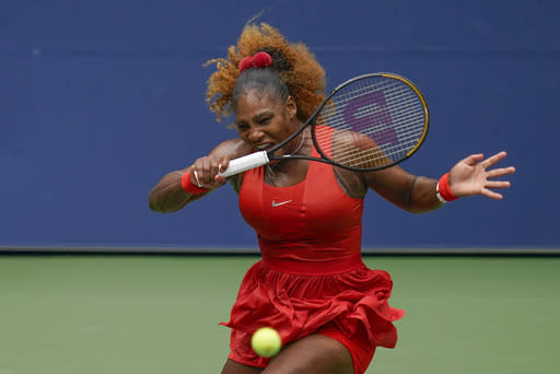 Serena Williams, of the United States, returns a shot to Tsvetana Pironkova, of Bulgaria, during the quarterfinals of the US Open tennis championships, Wednesday, Sept. 9, 2020, in New York. (AP Photo/Seth Wenig)