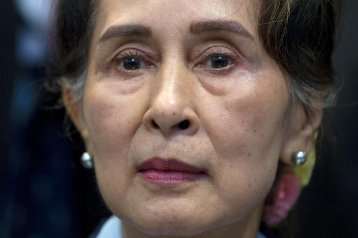 FILE - In this Dec. 11, 2019, file photo, Myanmar's leader Aung San Suu Kyi waits to address judges of the International Court of Justice on the second day of three days of hearings in The Hague, Netherlands. Reports says Monday, Feb. 1, 2021 a military coup has taken place in Myanmar and Suu Kyi has been detained under house arrest. (AP Photo/Peter Dejong, File)