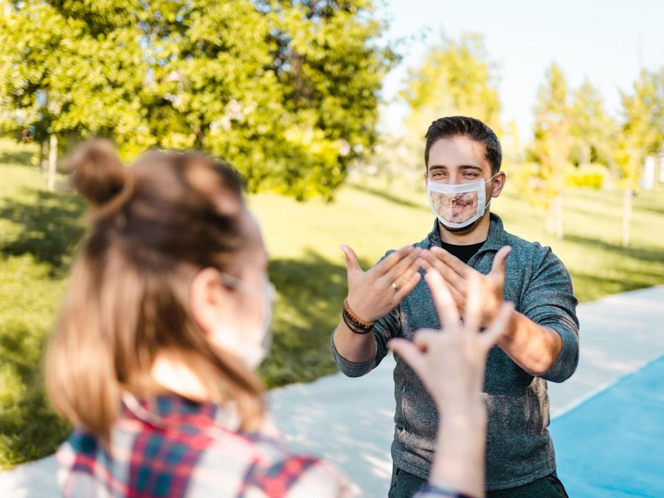 While not as widely available as cloth face coverings, you can find transparent face masks online (iStock)