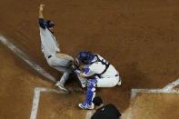 Los Angeles Dodgers catcher Will Smith tags out Tampa Bay Rays' Manuel Margot at home during the second inning in Game 2 of the baseball World Series Wednesday, Oct. 21, 2020, in Arlington, Texas. (AP Photo/David J. Phillip)