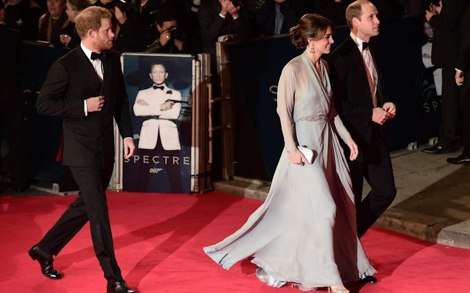 Prince Harry, Catherine, Duchess of Cambridge and Prince William arrive for the world premiere of Spectre in 2015