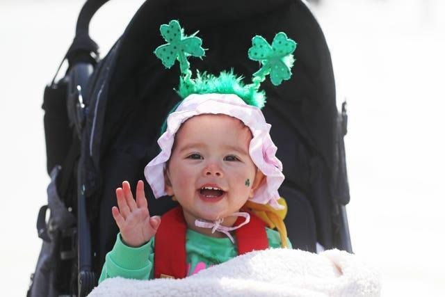Grace Wang, 18 months, dressed up to celebrate St Patrick's Day on O'Connell Street (Brian Lawless/PA)