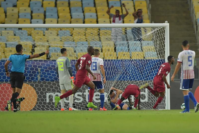 Qatar's players celebrate after Boualem Khoukhi scores the equalizer in their 2-2 Copa America draw with Paraguay
