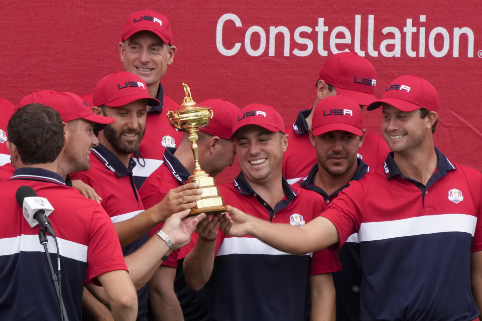 Team USA holds the trophy after the Ryder Cup matches at the Whistling Straits Golf Course Sunday, Sept. 26, 2021, in Sheboygan, Wis. (AP Photo/Charlie Neibergall)