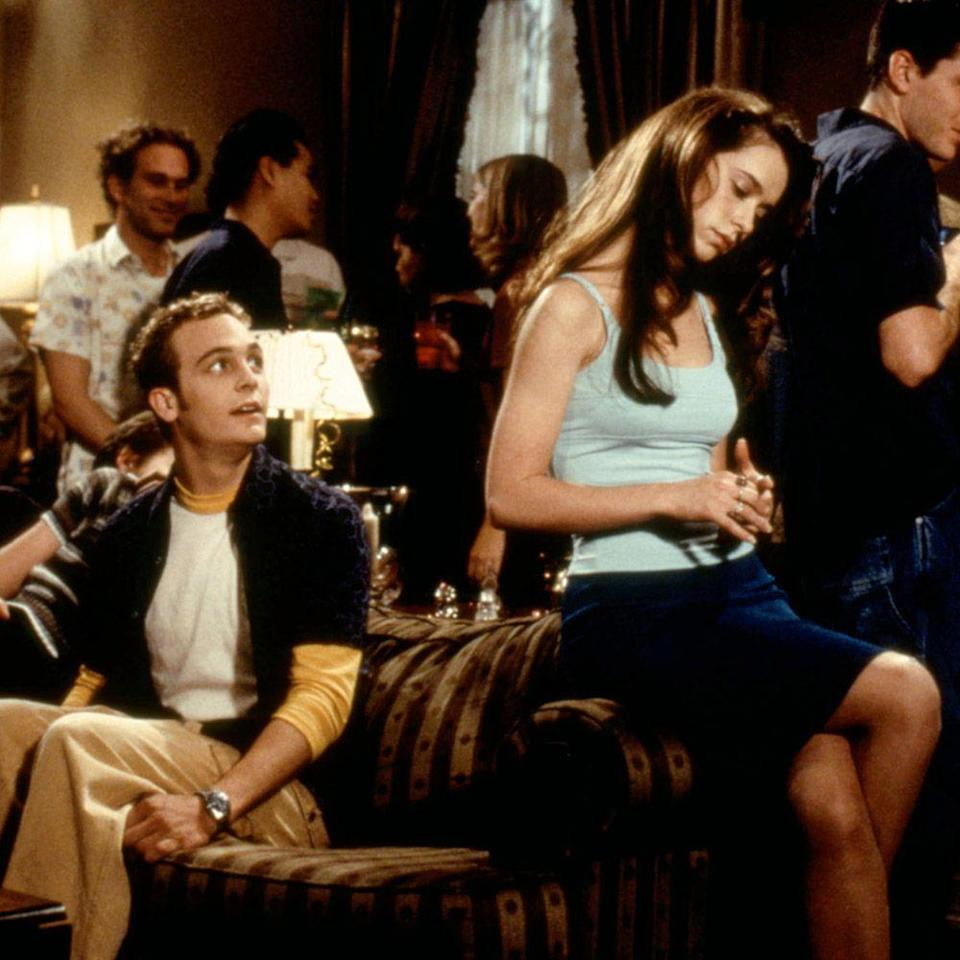 """<p>Navigating the horn-ball minefield that is adolescence are the cast of <em>Can't Hardly Wait</em>: Ethan Embry and Jennifer Love Hewitt, among many others. Pummeled by critics yet adored by Gen Xers, the raunch teen comedy is now a cult classic—and to borrow slang from Seth Green's Kenny """"Special K"""" Fisher, it's still got flava. Just look to the film's robust soundtrack, a time capsule spilling over with '80s and '90s hits including """"<a href=""""https://www.youtube.com/watch?v=gmrC_Pij5gc"""" rel=""""nofollow noopener"""" target=""""_blank"""" data-ylk=""""slk:Graduate"""" class=""""link rapid-noclick-resp"""">Graduate</a>"""" by Third Eye Blind, """"<a href=""""https://www.youtube.com/watch?v=sT0g16_LQaQ"""" rel=""""nofollow noopener"""" target=""""_blank"""" data-ylk=""""slk:Dammit"""" class=""""link rapid-noclick-resp"""">Dammit</a>"""" by Blink-182, and """"<a href=""""https://www.youtube.com/watch?v=l-O5IHVhWj0"""" rel=""""nofollow noopener"""" target=""""_blank"""" data-ylk=""""slk:It's Tricky"""" class=""""link rapid-noclick-resp"""">It's Tricky</a>"""" by Run DMC. And of course, you can't have a movie about the '90s without the occasional <a href=""""https://www.youtube.com/watch?v=6xCkg2pWmAw"""" rel=""""nofollow noopener"""" target=""""_blank"""" data-ylk=""""slk:Smash Mouth"""" class=""""link rapid-noclick-resp"""">Smash Mouth</a> hit. </p><p><a class=""""link rapid-noclick-resp"""" href=""""https://www.amazon.com/Cant-Hardly-Wait-Jennifer-Hewitt/dp/B000I8HIRC?tag=syn-yahoo-20&ascsubtag=%5Bartid%7C10056.g.32872244%5Bsrc%7Cyahoo-us"""" rel=""""nofollow noopener"""" target=""""_blank"""" data-ylk=""""slk:Watch and Listen"""">Watch and Listen </a></p>"""