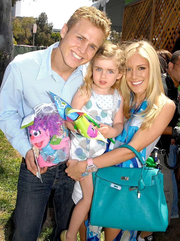"Spencer Pratt and Heidi Montag's young friend appears to be dazed by their dazzling white smiles. Barry King/<a href=""http://www.wireimage.com"" target=""new"">WireImage.com</a> - June 8, 2008"