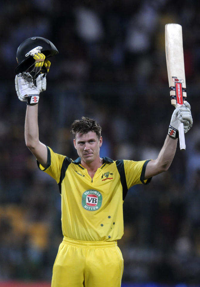 James Faulkner of Australia raises his bat after scoring a century during the seventh Star Sports Series One Day International (ODI) between India and Australia held at the M. Chinnaswamy Stadium, Bengaluru on the 2nd November 2013  Photo by Pal Pillai - BCCI - SPORTZPICS    Use of this image is subject to the terms and conditions as outlined by the BCCI. These terms can be found by following this link:  https://ec.yimg.com/ec?url=http%3a%2f%2fsportzpics.photoshelter.com%2fgallery%2fBCCI-Image-terms-and-conditions%2fG00004IIt7eWyCv4%2fC0000ubZaQCkIRgQ&t=1506423571&sig=D18vEVv0han8onZkYbiIIA--~D