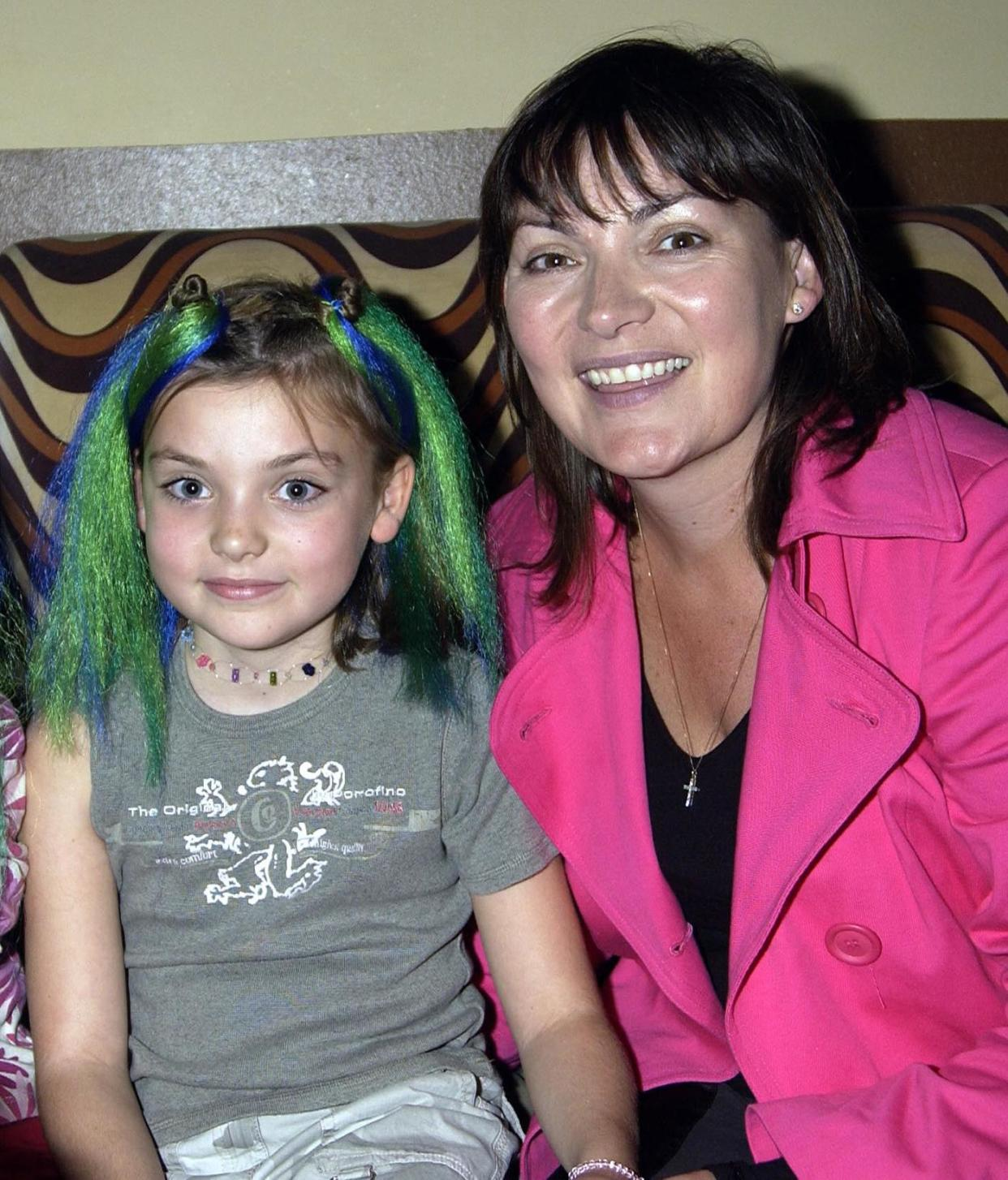 Lorraine Kelly, seen here with a young Rosie, reveals she's loving working with her daughter on their new podcast (Image: Getty Images)