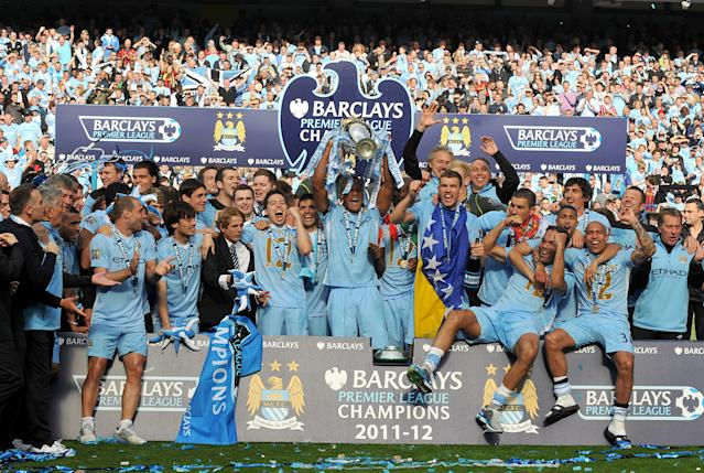 Manchester City celebrate winning the Premier League in 2012 (Photo by Ed Garvey/Manchester City FC via Getty Images)