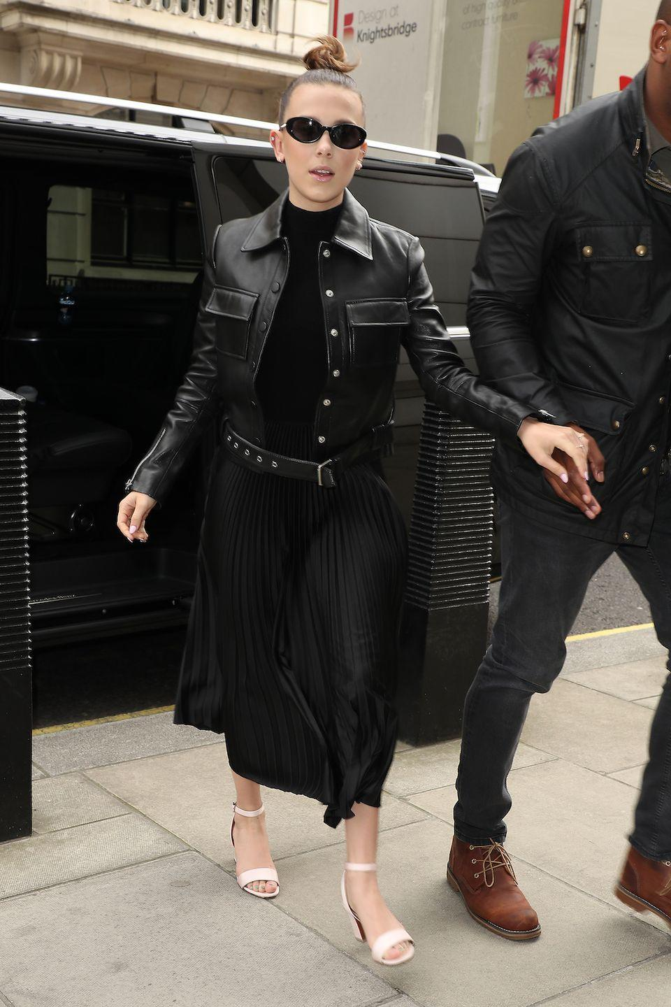 <p>Classic Millie! She injected a little retro glamour to edgy staples (the leather jacket, the inky sweater) with vintage-y cat eye sunglasses and powder pink heels.</p>