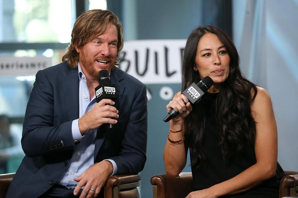 Chip Gaines and Joanna Gaines speak at an event