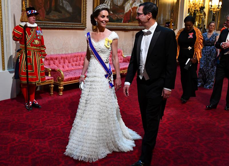 The Duchess of Cambridge pictured entering the State Banquet with a smile on her face