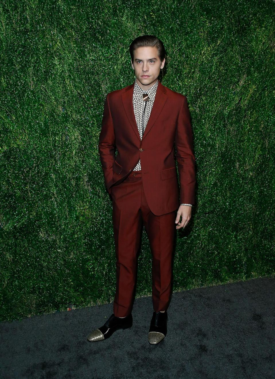 <p>The twin of 'Riverdale' star Cole Sprouse, Dylan looked dapper at the fashion event in a maroon suit by menswear designer David Hart. <span><em>[Photo: Getty]</em></span> </p>