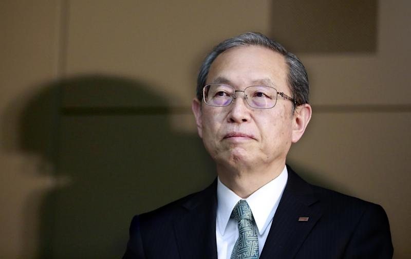 """Toshiba Corp. President Satoshi Tsunakawa listens to a reporter's question during a press conference at the company's headquarters in Tokyo, Tuesday, Feb. 14, 2017. Japanese electronics and energy giant Toshiba said Tuesday that its chairman is resigning to take responsibility for problems that will result in a 713 billion yen ($6.3 billion) loss in its nuclear business. Toshiba warned, however, that unaudited financial results it announced may change """"by a wide margin."""" It earlier delayed reporting its official financial results by a month, citing auditing problems related to the losses in its nuclear business. That sent Toshiba stock tumbling 8 percent in Tokyo trading. (AP Photo/Shizuo Kambayashi)"""
