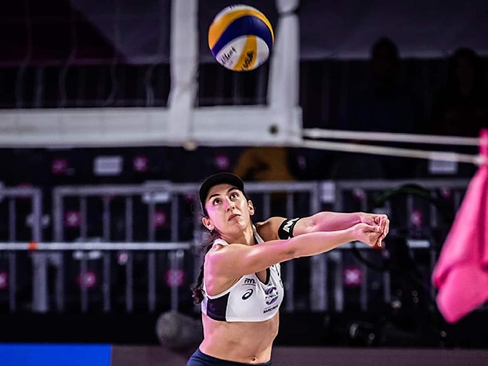 Melissa Humana-Paredes, pictured, and Canadian beach volleyball teammate Sarah Pavan dominated reigning Olympic champions April Ross and Alix Klineman for a straight-sets semifinal win at the FIVB World Tour Finals on Saturday in Sardinia. (Submitted by Volleyball World - image credit)