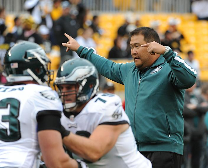 PITTSBURGH, PA - OCTOBER 7:  Offensive line assistant Eugene Chung of the Philadelphia Eagles directs players during pregame warmup prior to a game against the Pittsburgh Steelers at Heinz Field on October 7, 2012 in Pittsburgh, Pennsylvania.  The Steelers defeated the Eagles 16-14.  (Photo by George Gojkovich/Getty Images)